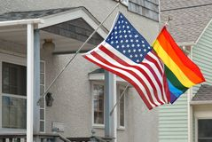 Rainbow and American flags. Stock Images