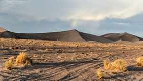 Rainbow amongst Sand Dunes in the Amargosa Desert. Sand Dunes and rainbows along the Amargosa Desert at sunset. Located in Nye County in western Nevada, United Stock Images