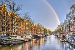 Rainbow in Amsterdam. Rainbow over a houseboat-lined canal called Brouwersgracht in Amsterdam stock photography