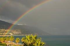 Rainbow appeared after heavy rain. Beautiful landscape photo. Marina di Patti. Sicily Stock Images