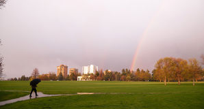 Rainbow Appears Over Park During Thunderstorm Pedestrian Umbrella Royalty Free Stock Photography