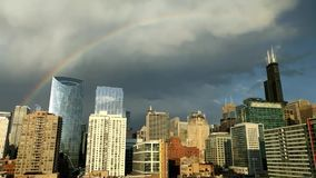 Rainbow and storm clouds over Chicago`s Loop. stock video