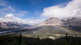 A rainbow appears during a summer shower at Sarbach Lookout Stock Photography