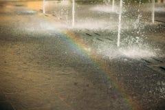 Rainbow apperead from the fountain stock photos