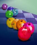 Rainbow Apples on plaid. Apples arranged according to the color spectrum Stock Image