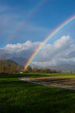 Rainbow arch after the autumn rain Stock Images
