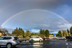 Rainbow Over Burien 4. A rainbow arcs over Burien, Washington royalty free stock images