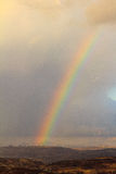 Rainbow in the Ariel mountains. Winter Royalty Free Stock Photo