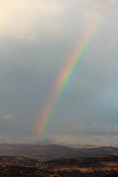 Rainbow in the Ariel mountains, winter, Israel.  Royalty Free Stock Images