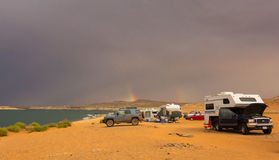 A rainbow as seen from a campground in the desert Stock Images