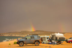 A rainbow as seen from a campground in the desert Royalty Free Stock Photos
