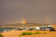 A rainbow as seen from a campground in the desert Royalty Free Stock Image