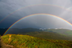 Free Rainbow At The Summit Of Mont Ernest Laforce Royalty Free Stock Image - 98899156