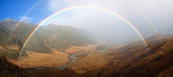 Rainbow in Autumn mountain valley Stock Photos