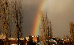 Rainbow and autumn sky above the city Stock Photos