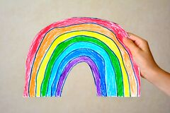 Rainbow baby hand drawn, cut out of paper
