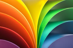 Rainbow background. Abstract rainbow background with colored paper.Dark tones
