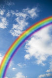 Rainbow background. Abstract rainbow colors background on blue sky royalty free stock photo