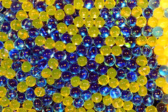 Rainbow background. Of colored transparent gel balls Royalty Free Stock Photos