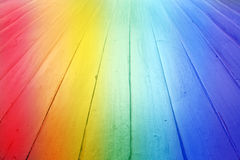 Rainbow Wood Background. A rainbow background made of wood as seen from a low angle Royalty Free Stock Photo