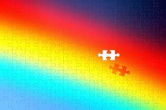 rainbow background of a puzzle with one pieces royalty free stock photography