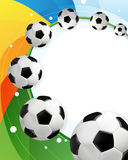 Rainbow background and soccer balls Stock Photo