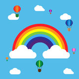 Rainbow with balloons and clouds. In flat design on the blue background Stock Photo
