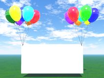 Rainbow balloons with empty blank. Green grass, blue sky and rainbow balloons with empty blank Stock Photography