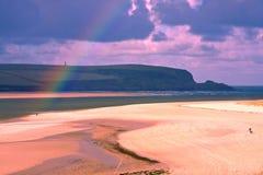 Rainbow on the beach. Sand, Sea, River and Beach with a rainbow in autumn Stock Photography