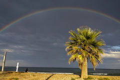 Rainbow Beach and Clouds Stock Images