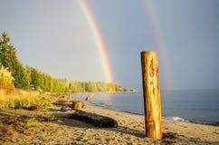 Rainbow on the beach. In golden light Royalty Free Stock Photos
