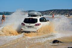 4WD Hyundai car driving across a washout in Queensland. Rainbow Beach, Queensland, Australia - December 23, 2017. 4WD Hyundai car driving across a washout in Stock Photo