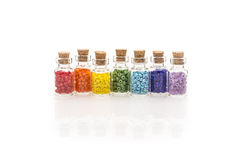 Rainbow beads in tiny glass bottles Stock Photography