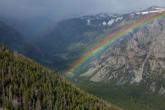 Rainbow at Beartooth Pass. A rainbow over the mountains at Beartooth Pass in Montana stock images
