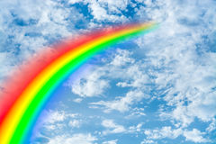 Rainbow and beautiful blue cloudy sky conceptual photo. Royalty Free Stock Images