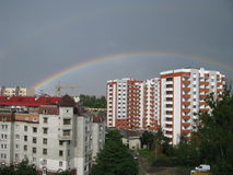 Rainbow. Beautiful rainbow in blue sky after the rain over sity Royalty Free Stock Images