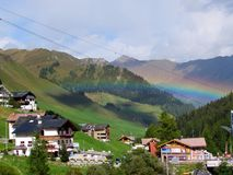 The Rainbow. Beautiful colorful rainbow during the afternoon royalty free stock image