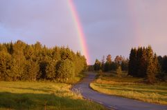 Rainbow. Beautiful rainbow over the landscape at 3 ó clock in the morning Royalty Free Stock Photo