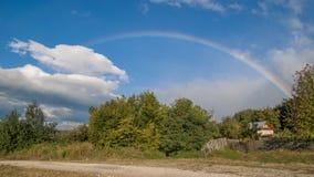 Rainbow. Beautiful rainbow after a summer storm Stock Image