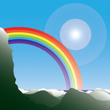 Rainbow behind the mountain Royalty Free Stock Images