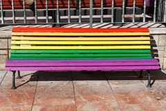 Rainbow bench painted in the colors of LGBT pride flag on Plaza de La Escandalera in Oviedo, Asturias, Spain stock photos