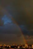 Rainbow. Big city. Stock Photos