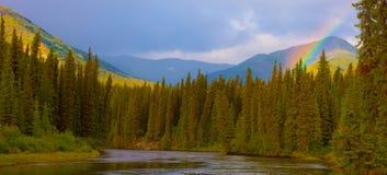 Rainbow at Big Salmon River. Rainbow in beautiful valley of Big Salmon River, Yukon Territory, Canada Royalty Free Stock Photo
