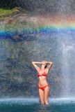 Rainbow bikini waterfalls Stock Photo