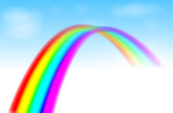 Rainbow in the blue sky Stock Photo