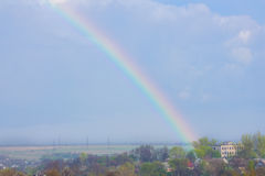 Rainbow in the blue sky as background Royalty Free Stock Photos
