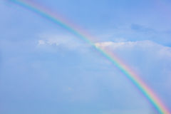 Rainbow in the blue sky as background Royalty Free Stock Images