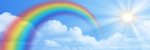 Rainbow on the blue sky banner Stock Images