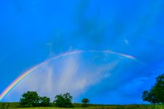 Rainbow in a blue sky after the rain Royalty Free Stock Photo