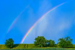 Rainbow in a blue sky after the rain Royalty Free Stock Photography